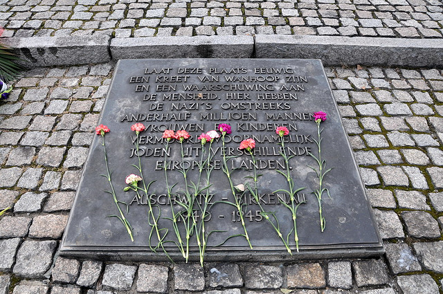 A memorial stone marks the place where millions died at Auschwitz-Birkenau at the hands of the Nazis. Photo taken September 24, 2009 (FaceMePLS/Creative Commons/Flickr)