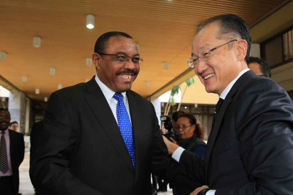 World Bank Group President, Jim Yong Kim (right) is warmly greeted by Prime Minister of Ethiopia, Hailemariam Desalegn in Addis Ababa, Ethiopia on October 27, 2014. Photo © Dominic Chavez/World Bank