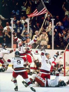 The US Hockey team celebrates after defeating the USSR in the 1980 winter games. (Credit: Sports Illustrated)